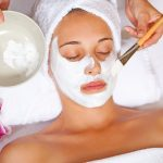 woman at spa having relaxing face mask